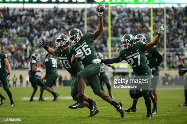 Michigan State Spartans linebacker Brandon BouyerRandle runs off the field with safety Khari Willis and defensive end Kenny Willikes following a...
