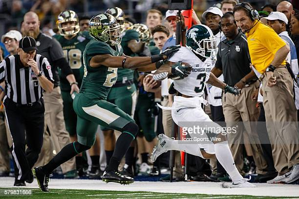 Michigan State Spartans Macgarrett Kings Jr is chased by Baylor Bears safety Orion Stewart during the Goodyear Cotton Bowl Classic between the...