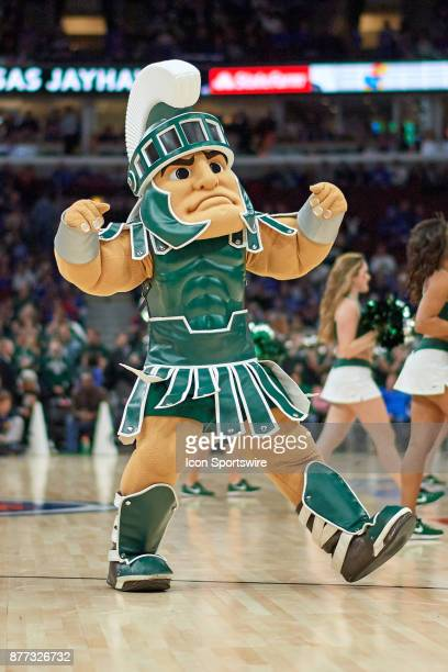 Michigan State Spartans mascot Sparty and cheerleaders perform during the State Farm Classic Champions Classic game between the Duke Blue Devils and...