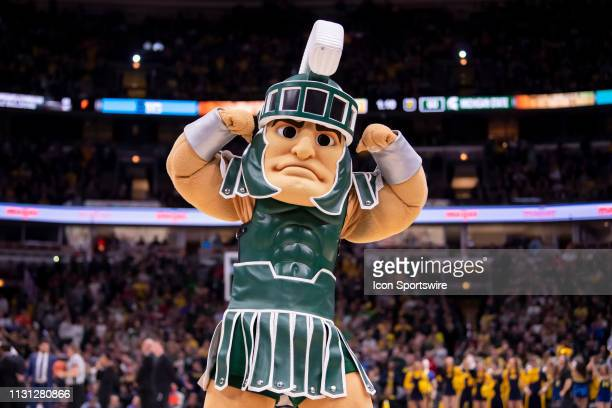 Michigan State Spartans mascot Sparty flexes during the Big Ten Tournament championship game between the Michigan State Spartans and the Michigan...