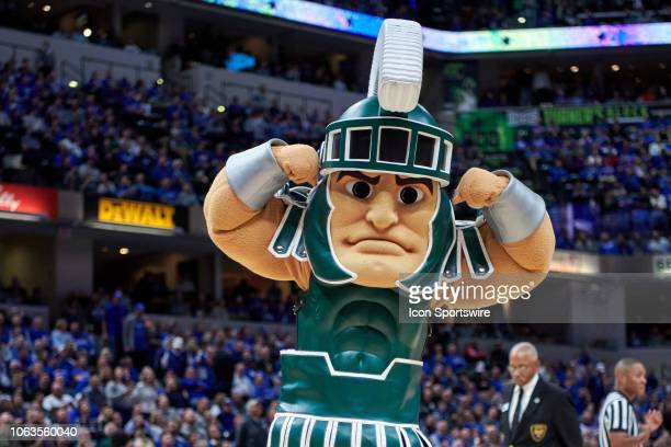 Michigan State Spartans mascot Sparty flexes in action during a Champions Classic game between the Michigan State Spartans and the Kansas Jayhawks on...