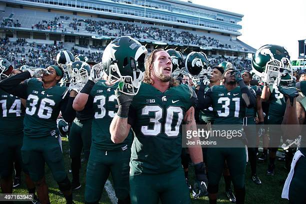 Michigan State Spartans players celebrate after the game against the Maryland Terrapins at Spartan Stadium on November 14, 2015 in East Lansing,...