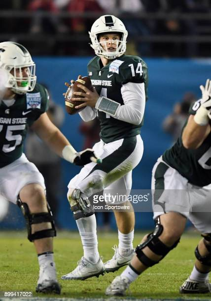 Michigan State Spartans quarterback Brian Lewerke back to pass from the pocket in the first quarter of the Holiday Bowl played against the Washington...