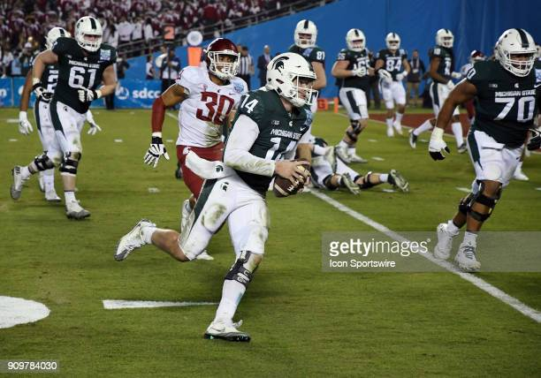 Michigan State Spartans quarterback Brian Lewerke scrambles with the ball and heads towards the end zone in the second half of the Holiday Bowl...