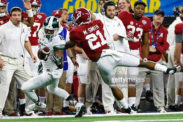 Michigan State Spartans wide receiver Aaron Burbridge fumbles with Alabama Crimson Tide defensive back Maurice Smith defending during the NCAA...