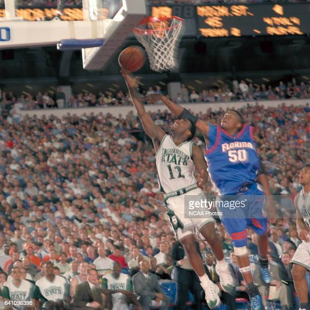 Michigan State University guardMateen Cleaves and University of Florida center Udonis Haslem during the NCAA Photos via Getty Images Division 1 Men's...