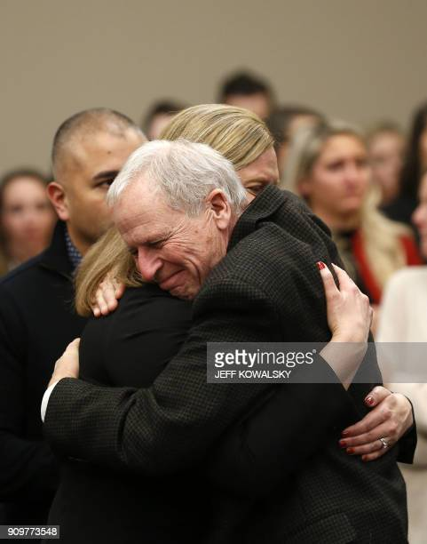 Michigan State University Police Chief Jim Dunlap hugs Asst Michigan Attorney General Angela M Povilaitis after former Michigan State University and...