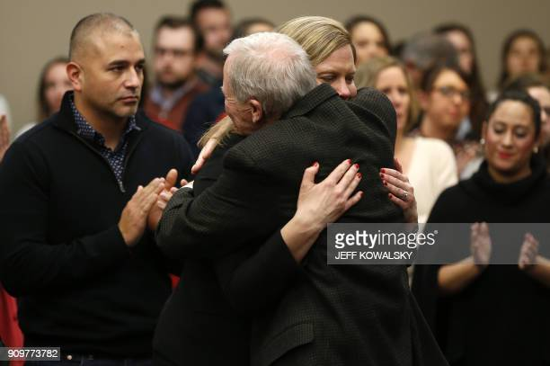 Michigan State University Police Chief Jim Dunlap hugs Asst Michigan Attorney General Angela M Povilaitis after former Michigan State University and...