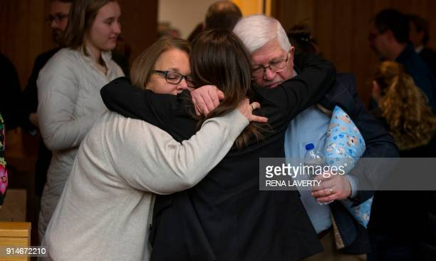 Michigan State University police detective Andrea Mumford greets the parents of former gymnast Ashley Erickson at the conclusion of the sentencing of...