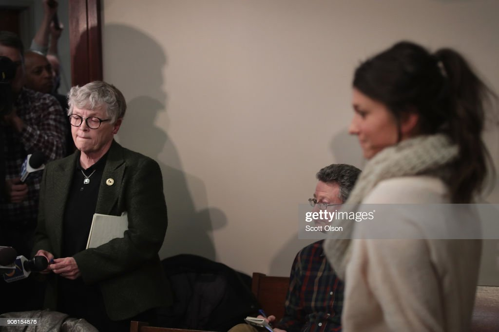 Michigan State University (MSU) President Lou Anna Simon (L) answers a question after being confronted by former MSU gymnast Lidsey Lemke (R) during a break in the sentencing hearing for Larry Nassar who has been accused of molesting more than 100 girls while he was a physician for USA Gymnastics and Michigan State University where he had his sports-medicine practice on January 17, 2018 in Lansing, Michigan. Nassar has pleaded guilty in Ingham County, Michigan, to sexually assaulting seven girls, but the judge is allowing all his accusers to speak. Nassar is currently serving a 60-year sentence in federal prison for possession of child pornography.