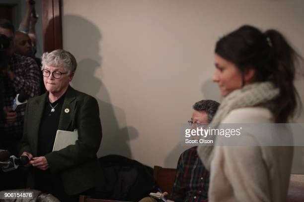 Michigan State University President Lou Anna Simon answers a question after being confronted by former MSU gymnast Lidsey Lemke during a break in the...