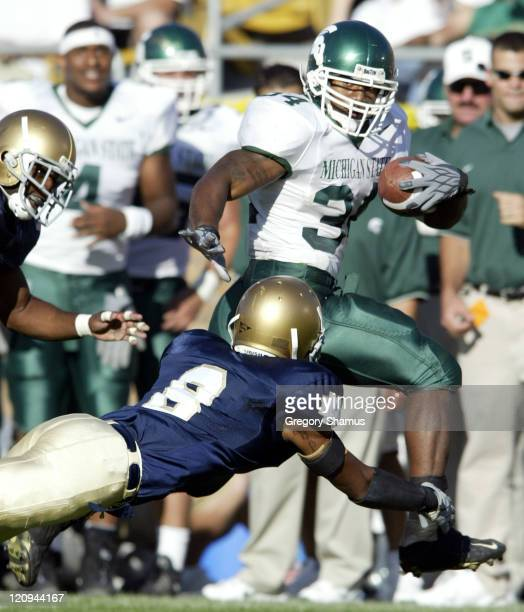 Michigan State University RB Tyrell Dortch sprints down the sideline past the reach of University of Notre Dame FS Quentin Burrell during 4th quarter...
