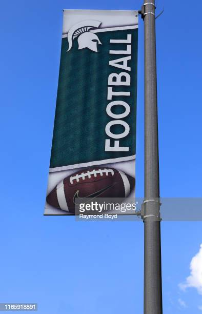 Michigan State University Spartans football banner flies outside Spartans Stadium, home of the Michigan State University Spartans football team in...