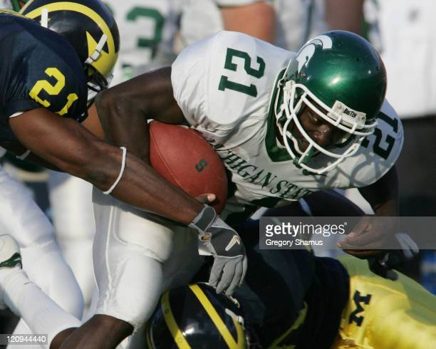 Michigan State's DeAndra Cobb fights for extra yards during a game against Michigan at Michigan Stadium on October 30 2004 Michigan won the game 4537...