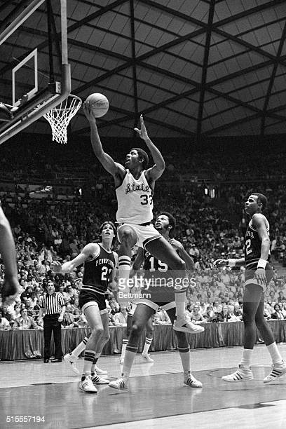 """Michigan State's Earvin """"Magic"""" Johnson drives past Indiana State's Carl Nicks for a basket. Johnson led the Spartans to the NCAA basketball..."""