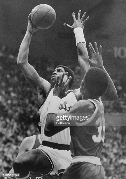 "Michigan State's guard Earvin Johnson does his ""magic"" thing as he drives up and around LSU's forward Richard Kaye for a 2-point layup shot in 1st..."