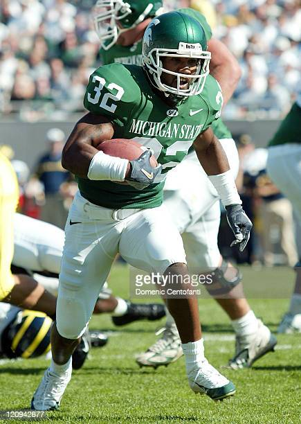 Michigan State's junior running back Jerramy Scott runs the ball up the middle versus Michigan Oct 1 in East Lansing Michigan