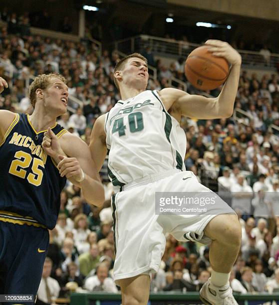 Michigan State's Paul Davis grabs a rebound while being pulled down by Graham Brown Shannon Brown scored 26 points and No 16 Michigan State remained...