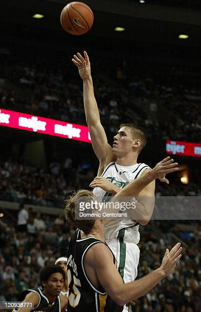 Michigan State's Paul Davis shoots over Wichita State's Paul Miller in the first half Wichita State played Michigan State in the Spartan Clash at the...