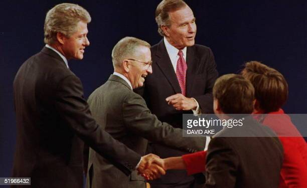 Michigan US presidential candidates Bill Clinton Ross Perot and President George Bush shake hands with the panelists after the conclusion of their...