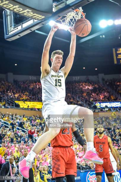 Michigan Wolverines center Jon Teske dunks on an alley oop pass during the Michigan Wolverines game versus the Maryland Terrapins on Saturday...