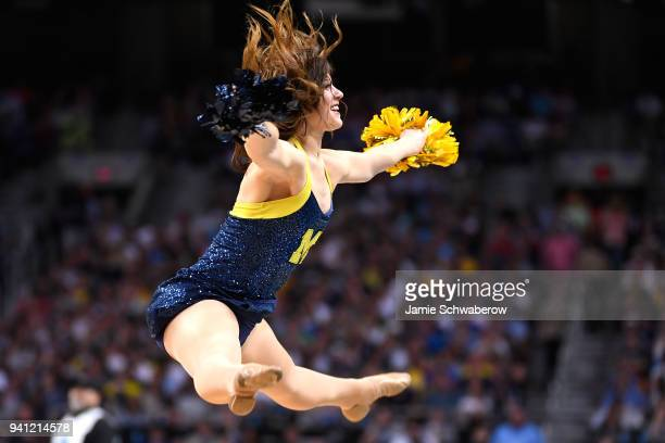 Michigan Wolverines cheerleader performs against the Villanova Wildcats in the 2018 NCAA Photos via Getty Images Men's Final Four National...