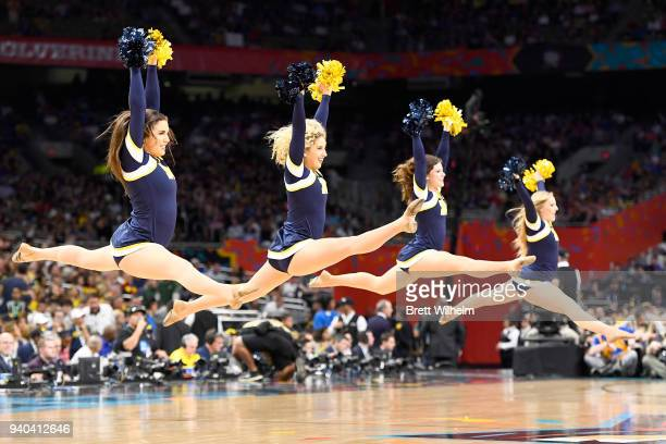 Michigan Wolverines cheerleaders perform during the first half against the Loyola Ramblers in the 2018 NCAA Photos via Getty Images Men's Final Four...
