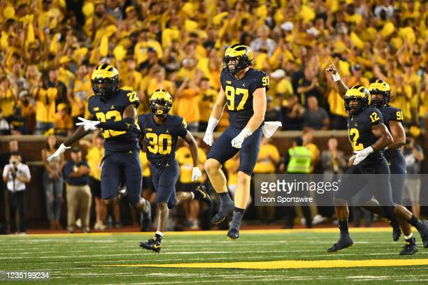 Michigan Wolverines defensive end Aidan Hutchinson celebrates a big stop on fourth down during the Michigan Wolverines vs Washington Huskies game on...