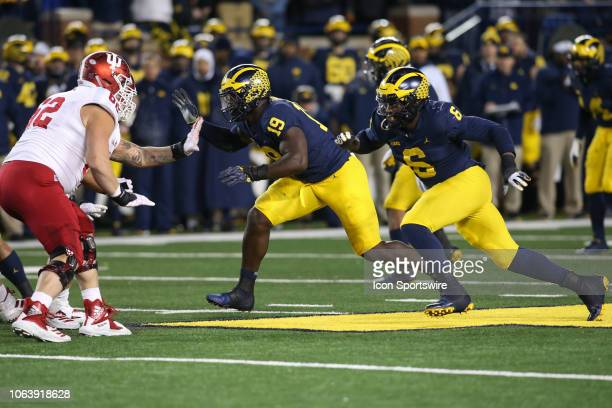 Michigan Wolverines defensive lineman Kwity Paye and Michigan Wolverines linebacker Josh Uche rush during a game between the Indiana Hoosiers and the...