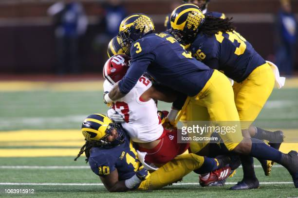 Michigan Wolverines defensive lineman Rashan Gary Michigan Wolverines linebacker Devin Bush and Michigan Wolverines linebacker Devin Gil tackle...