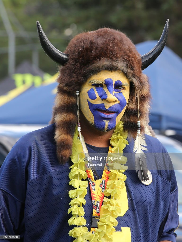 A Michigan Wolverines fan gets ready for the game against the Michigan State Spartans at Michigan Stadium on October 7, 2017 in Ann Arbor, Michigan.