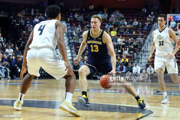 Michigan Wolverines forward Ignas Brazdeikis drives to the basket during a college basketball game between Michigan Wolverines and George Washington...
