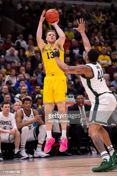 Michigan Wolverines forward Ignas Brazdeikis goes up for a shot during the Big Ten Tournament championship game between the Michigan State Spartans...