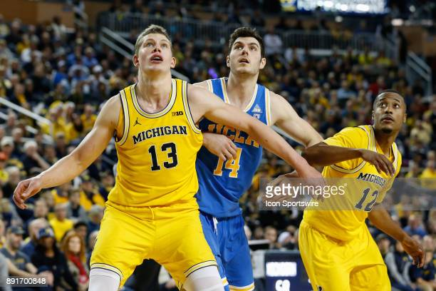 Michigan Wolverines forward Moritz Wagner and Michigan Wolverines guard MuhammadAli AbdurRahkman box out UCLA Bruins forward Gyorgy Goloman during a...