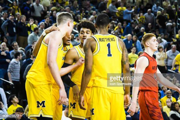 Michigan Wolverines forward Moritz Wagner and Michigan Wolverines guard Charles Matthews talk with Michigan Wolverines guard Jordan Poole after a...