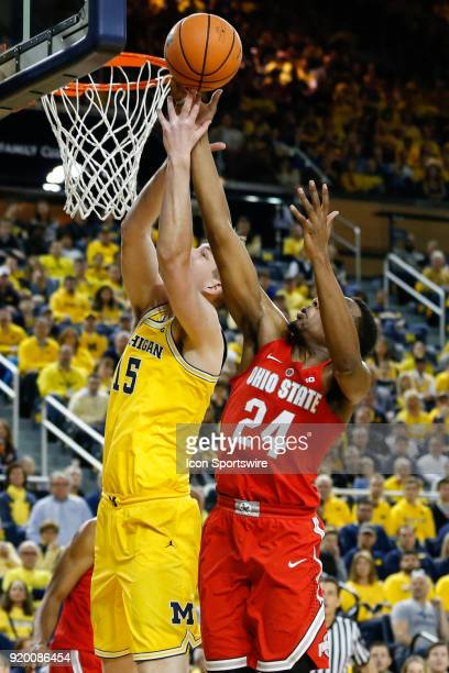 Michigan Wolverines forward Moritz Wagner and Ohio State Buckeyes forward Andre Wesson battle to grab a rebound during the first half of a regular...