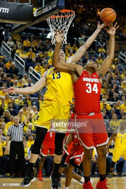 Michigan Wolverines forward Moritz Wagner and Ohio State Buckeyes forward Kaleb Wesson battle to grab a rebound during a regular season Big 10...