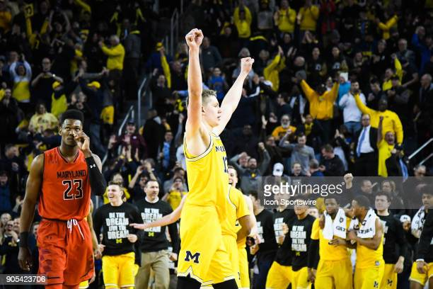 Michigan Wolverines forward Moritz Wagner and the Michigan Wolverines bench erupt following the free throws to put them ahead for the winning score...