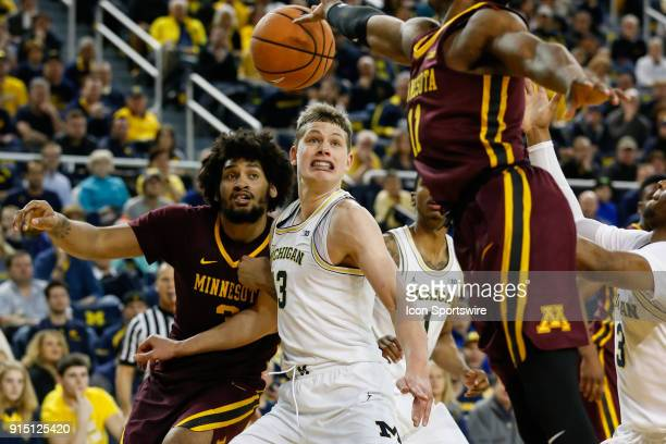 Michigan Wolverines forward Moritz Wagner battles for rebounding position against Minnesota Golden Gophers forward Jordan Murphy during a regular...