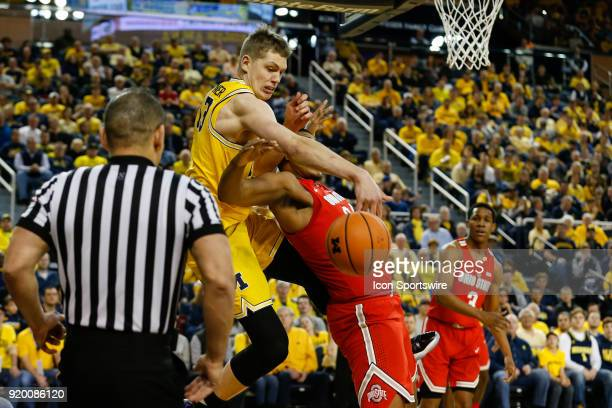 Michigan Wolverines forward Moritz Wagner battles to grab a rebound against Ohio State Buckeyes forward Kaleb Wesson during the first half of a...