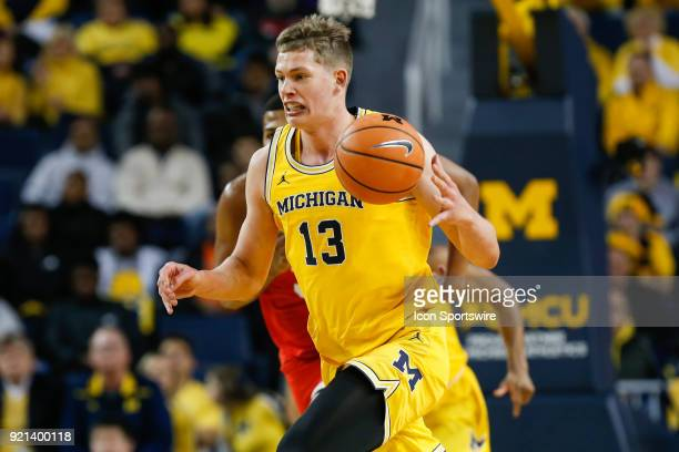 Michigan Wolverines forward Moritz Wagner brings the ball up the court during a regular season Big 10 Conference basketball game between the Ohio...