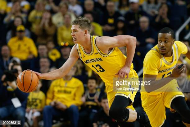 Michigan Wolverines forward Moritz Wagner brings the ball upcourt during the first half of a regular season Big 10 Conference basketball game between...