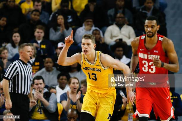 Michigan Wolverines forward Moritz Wagner celebrates an offensive play as he runs up the court during a regular season Big 10 Conference basketball...