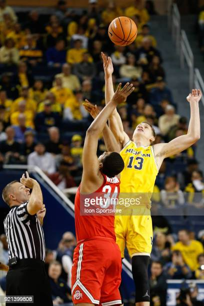 Michigan Wolverines forward Moritz Wagner controls the opening tip against Ohio State Buckeyes forward Kaleb Wesson during a regular season Big 10...