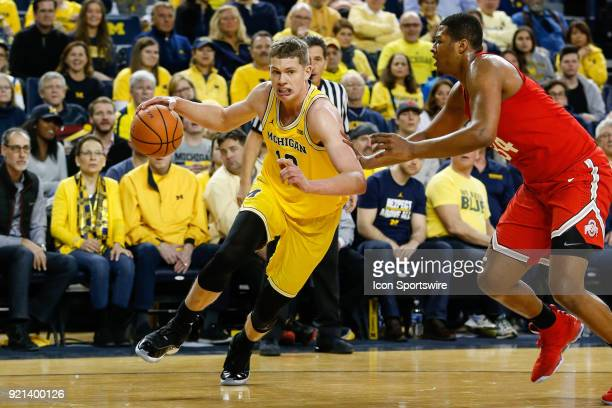 Michigan Wolverines forward Moritz Wagner drives to the basket against Ohio State Buckeyes forward Kaleb Wesson during a regular season Big 10...