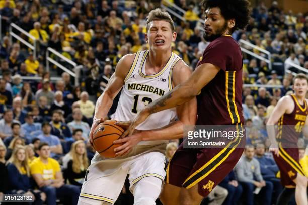 Michigan Wolverines forward Moritz Wagner drives to the basket against Minnesota Golden Gophers forward Jordan Murphy during a regular season Big 10...