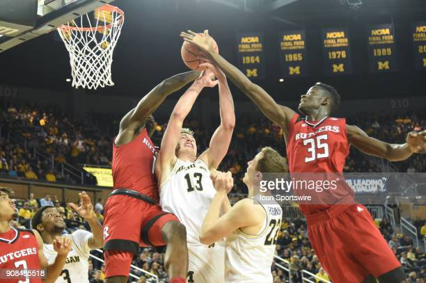Michigan Wolverines forward Moritz Wagner fights for this rebound with Rutgers Scarlet Knights forward Eugene Omoruyi and Rutgers Scarlet Knights...