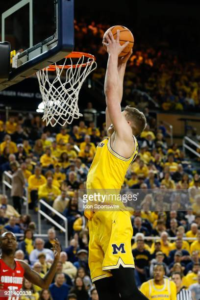 Michigan Wolverines forward Moritz Wagner goes in for a dunk during a regular season Big 10 Conference basketball game between the Ohio State...