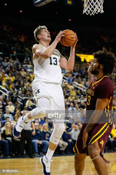 Michigan Wolverines forward Moritz Wagner goes in for a layup against Minnesota Golden Gophers forward Jordan Murphy during the first half of a...