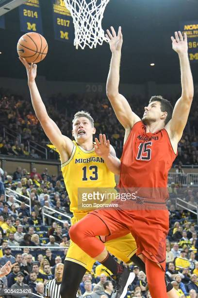 Michigan Wolverines forward Moritz Wagner goes in for a layup on Maryland Terrapins center Michal Cekovsky during the Michigan Wolverines game versus...